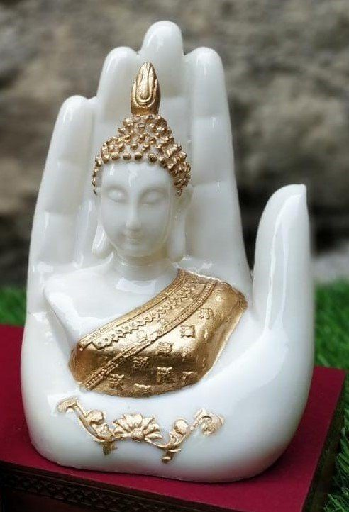 Buddha in palm of hand